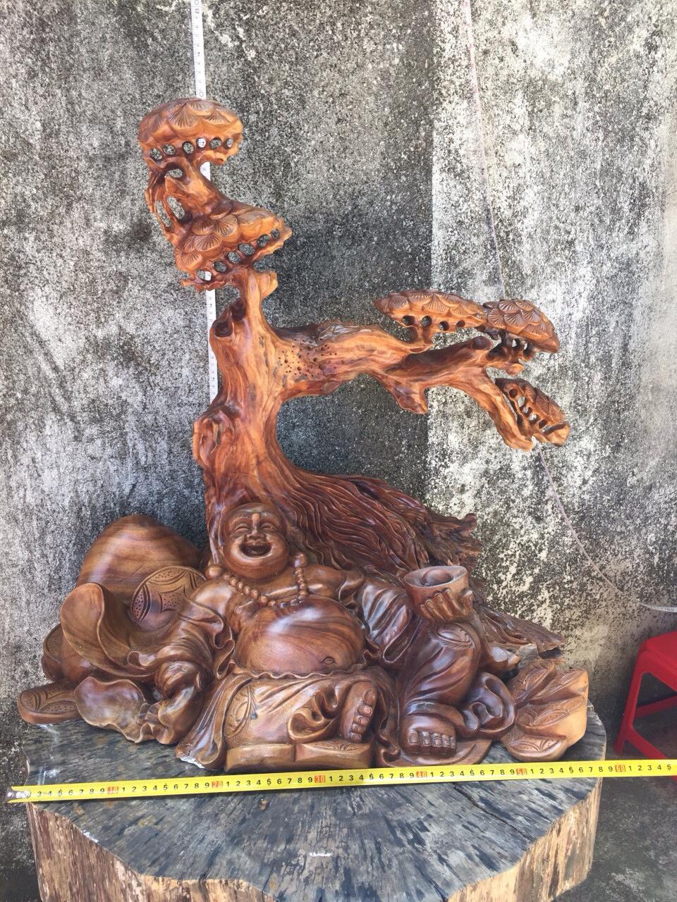 Tượng phật Di lặc gỗ xá xị – (XX06) – ngang 65cm x cao 68cm x rộng (sâu)40cm