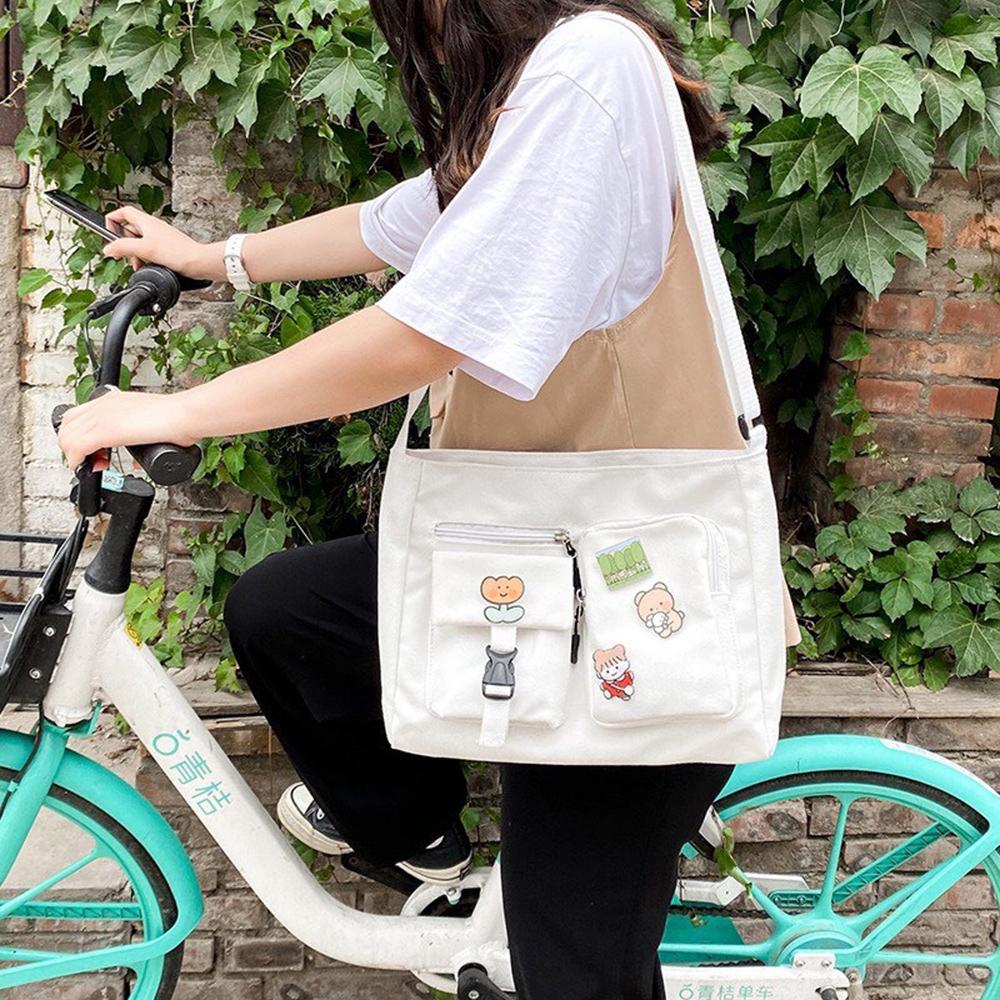 Túi đeo chéo nữ chất liệu vải canvas đựng được khổ giấy A4 có khóa miệng và ngăn phụ💖-THẾ GIỚI...