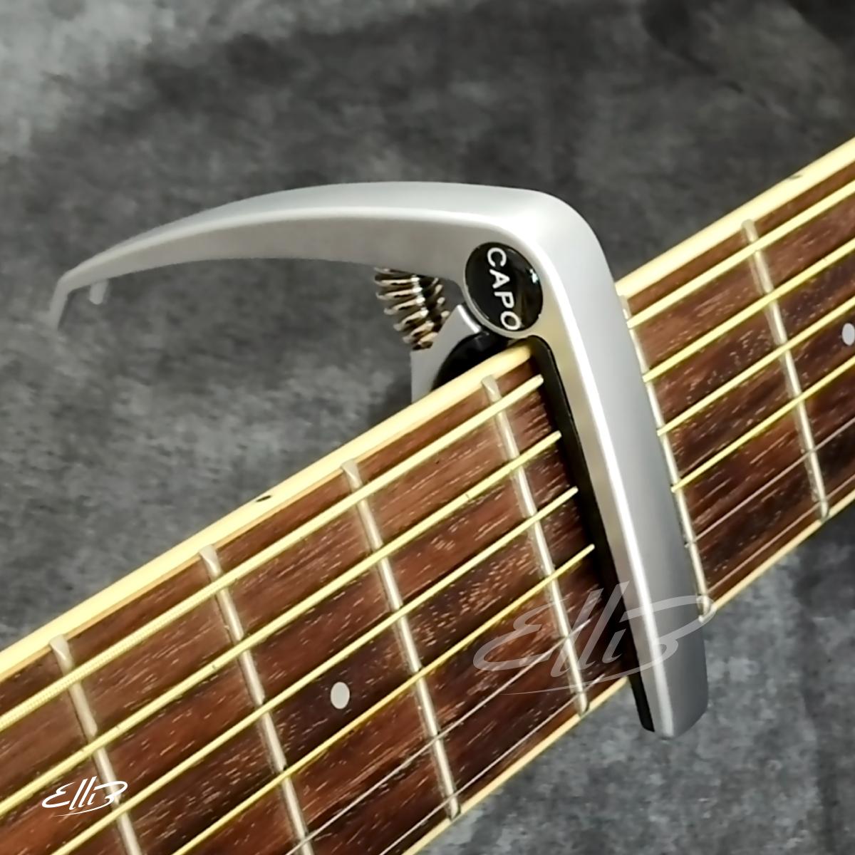 Capo Guitar cao cấp E202 (màu bạc – nhám) – kẹp tăng tông có kèm khoá mở chốt dây đàn