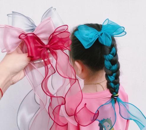 B395 – Dây buộc tóc nơ xoan dáng dài cho bé gái