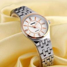 Đồng hồ nữ dây thép chống gỉ SKMEI 1133 (M Mặt trắng dây sọc vàng)