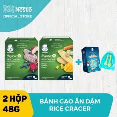 Bộ 2 Bánh gạo hữu cơ Gerber Organic vị việt quất táo củ cảo đỏ + vị chuối xoài cà rốt ( hộp 48g) + Tặng 1 Bộ chén ăn dặm phi thuyền