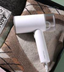 Bàn là hơi nước, bàn ủi quần áo công suất 1200W làm nóng nhanh, chế độ phun hơi nước thông minh, là phẳng quần áo, nhỏ gọn tiện lợi cho gia đình hoặc mang đi du lịch