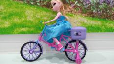 Búp bê baby Frozen đạp xe có đèn – 1070XD08