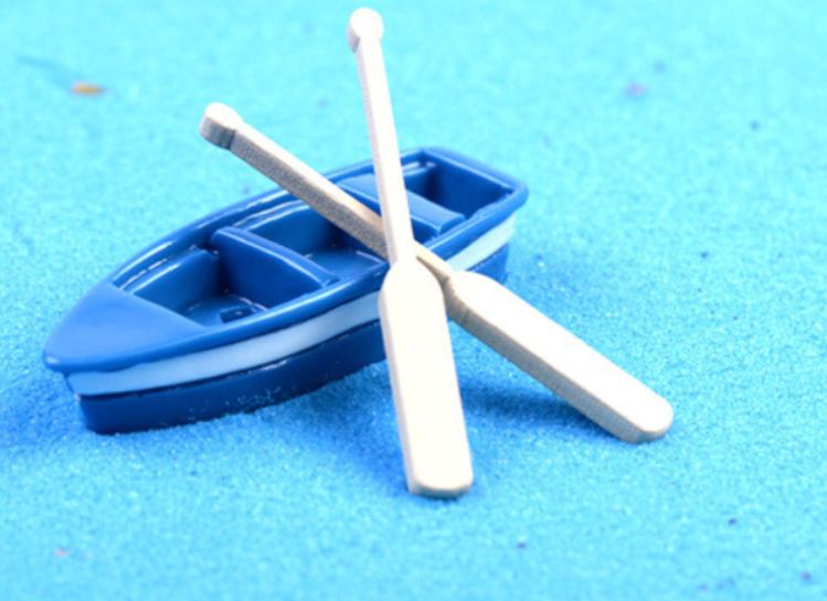 Mô hình thuyền du lịch và hai mái chèo