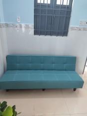 Sofa bed màu xanh ngọc may đường chỉ thẳng.