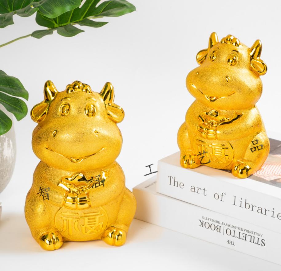 Hộp đưng tiền tiết kiệm hình chú Trâu vàng, sang trọng, quà tặng đẹp.